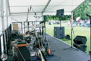 Wherever possible, the front-of-house speakers should be placed in front of the stage, so as not to direct any sound back into the microphones.