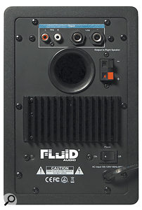 The left speaker houses the amps for both itself and the right speaker, the latter connecting via standard speaker-wire clips.