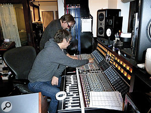 Brought in to mix the project, Alan Moulder (front) swiftly realised that he would be unable to recapture the same energy in aconventional studio, and decamped to Grohl's house to work on the same API desk as was used to record the album.