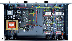 Lifting the lid on the PML200E reveals the Lundahl input and output transformers, the E88C valves, and the LCD 'hour meter' (the last is located top left, on the PSU board).