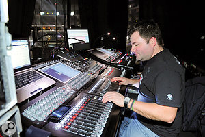 Monitor engineers Tom Pesa (right) and Mike Parker (left), at their mixing positions on either side of the stage.