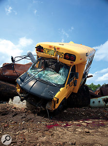 School's out forever! Acarelessly-parked school bus undergoes aradical makeover.