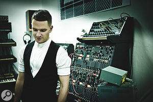 "Adam Anderson of Hurts: ""We recorded some bits in a synthesizer studio in Hamburg, Germany. In this picture I'm looking down at a mystery black, nameless box with Russian writing on it."""