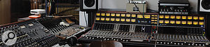Sonovox is home to several desirable analogue consoles. This panoramic photo shows, from left to right, the studio's Neve sidecar, UA solid-state mixer and API 1608 with expander, playing host to the Fulltone and Roland echo units that were heavily used on Mark Lawson's mix of 'Flashbulb Eyes'.