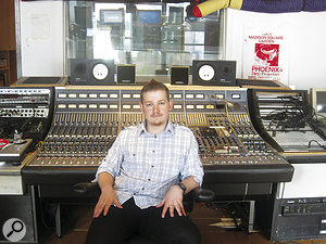 Oscilloscope Laboratories resident engineer Andre Kelman at the studio's vintage Neve desk.