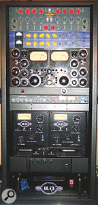 Five towering racks of outboard gear dominate Michael Brauer's mix room, and contain far too much equipment to list. Notable items used on the mix of Violet Hill include (first rack) Pye compressor, Empirical Labs Distressors, ADR Compex limiter, Chandler EMI TG12413 limiter, EAR 660 compressors and Fairchild 666 compressor; (second rack) Lexicon PCM81, Sony DRE S777, Akai S612, Bricasti M7, Zoom 1202, Rupert Neve Portico 5014; (third rack) Neve 33609, API modules, Moog EQ and Pendulum ES8 compressor; (fifth rack) Chandler EMI TG12345 Curver Bender, Shadow Hills compressor and ADL 670.