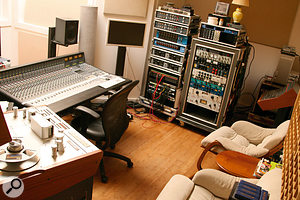Sleep Through The Static was recorded on a  24–track Studer reel–to–reel machine. The unique solar–powered studio is equipped with an SSL AWS900 mixer; Robert Carranza's own outboard gear is visible in the racks to the side of it.