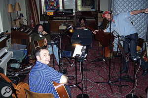 The band at work in Akademie Mathematique. Smokey Hormel is closest to the camera, Mike Campbell behind him and to the left, Johnny Polonsky is at the rear and Matt Sweeney right.