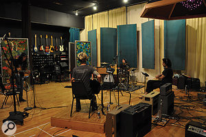 Slash, Dave Grohl and Duff McKagan lay down atake in the large live room at Barefoot, under the watchful eye of Eric Valentine (right).