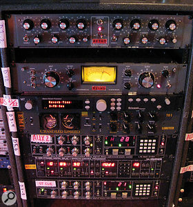 Adding his own gear to that resident at 5150 gave Ross Hogarth apowerful mixing arsenal. In this rack, from top, are aRetro Instruments 2A3 EQ and 176 compressor, Bricasti M7 reverb, Chandler TG1 limiter, and two AMS DMX 15-80 delays with aTC Electronic 2290 delay between.