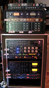 This rather fuzzy photo shows the labels illustrating how some of the other outboard gear was assigned. Visible from top are Empirical Labs EL7 Fatso tape simulator, SSL compressor, apair of Universal Audio LA3A compressors, another EL7, arack of API EQs, Neve 33609 compressor, apair of Empirical Labs Distressor compressors, API 2500 compressor, Eventide 2016 reverb, Slate Dragon compressors (x2) and Lexicon PCM42 delay (x2).