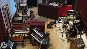 This photo shows the setup used at Blackbird, with Chris Kilmore's keyboards to the left, Michael Einziger's guitars to the right, and José Pasillas' drums in the background.
