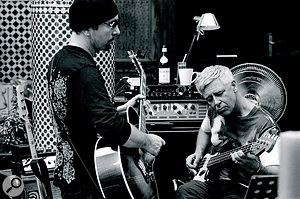 U2's The Edge and Adam Clayton thrash out an arrangement in Fez.
