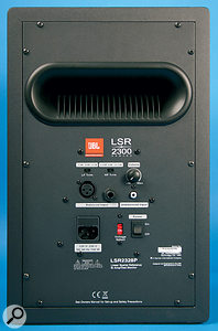 The rear panel of the LSR eight‑inch speaker, the 2328P, which includes a switchable voltage selector for the power inlet, as well as high and low trim filters. Also featured are balanced and unbalanced analogue audio inputs and a master volume knob.