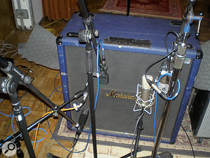 John Porter favours miking guitar cabs as close as possible. Here, his trusty SM57 (centre left) is joined by a Sennheiser MD421 (bottom left) and MD409 (centre-left), and a Neumann U67 and RCA 77 (right).