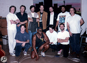 An all-star line-up assembles at Sound City Studios, Van Nuys in 1996 for Taj Mahal's Phantom Blues album. From left (standing): Mick Weaver (Hammond), Johnny Lee Schell and Eric Clapton (guitar), Joe Sublet (tenor sax), Jon Cleary (piano), Larry Fulcher (bass) and Tony Braunagel (drums); at front, Joe McGrath (engineer), Taj Mahal, Darrell Leonard (trumpet) and John Porter.