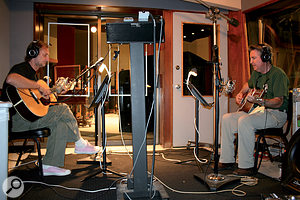 John Porter (left) and Johnny Lee Schnell track guitar overdubs at Hollywood's Capitol Studios.
