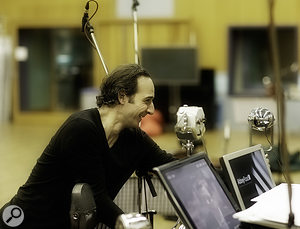 King's Speech composer Alexandre Desplat with Peter Cobbin's 'Royal Tree', set up in Abbey Road Studio One. This has the older King George V microphone, made of white marble, in the centre, with the Elizabeth and George VI models on either side.