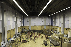 Studio One at Abbey Road is one of very few purpose‑built studios that can accommodate a full symphony orchestra. This shot was taken part‑way through setup for the smaller ensemble that recorded The King's Speech; around the conductor's position at lower left are visible three Neumann M50s in a Decca Tree formation.