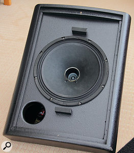 Removing the grille exposes the 10-inch woofer, with aone-inch compression driver mounted in the centre.