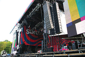 A main PA 'hang', right, showing a slight arc at the bottom to increase the coverage close to the stage. At Hungary's Sziget festival, the sub-bass cabinets were also 'flown': they are the two rows behind the line array. You can also see a small flown cluster in the centre, to cover the area just in front of the barrier, which is difficult to cover with the main system.