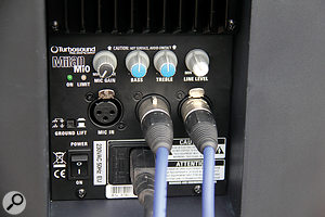The rear panel of the Mi0 is quite simple, including high and low shelf EQ and asimple mixer for the line and mic inputs. It's also well protected by the extended rear of the gas‑moulded cabinet.