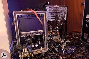Mic/source-level splitters are used to derive separate signals for broadcast and monitor mixes.