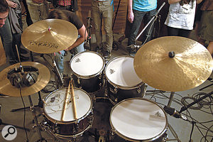 In addition to a  main Neumann TLM103 overhead pair (not shown), the drum kit had close mics on every drum: an SM57 on the snare; Neumann TLM102 condensers on the toms; an AKG D112 on the kick; and another TLM103 positioned alongside the snare.