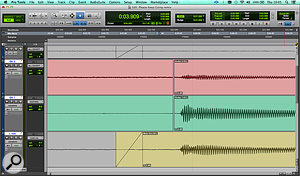 Zoomed in both horizontally and vertically, this screen shows the first note of the rhythm guitar, as it appears on its own track (centre), the lead vocal track (bottom) and the second guitar track (top). The edits on the guitar tracks show that those parts have been slipped by a  few samples, so as to time-align the guitar across all three. As you can see from the waveform, the second guitar was also quite noisy!