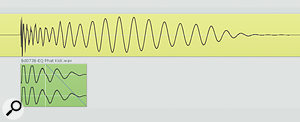 The yellow audio region here is the main kick‑drum sample, and you can see how the onset of the longer‑wavelength low‑frequency information is delayed compared to the start of the drum hit. This made the drum sound out of time. Mike's solution was to add an additional kick‑drum sample (green audio region) to beef up the low‑frequency attack. Notice how this has been shortened with afade‑out to avoid conflicting with the existing low-end energy.