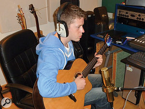 Tom McKenzie, tracking acoustic guitar for one of his tunes.