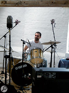Drummer Kev pauses between takes. Visible are the AKG C414s used for overhead mics, the D19s on toms, and an ancient GEC ribbon mic (top left) that Iput up as aroom mic.