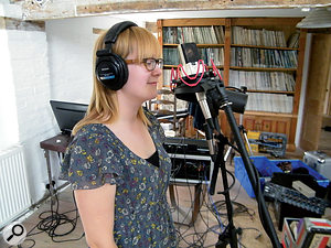 Rachel's overdubs were tracked with a C414 and an SM7 placed side-by-side.
