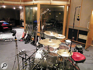 This photo shows Simon Askew's distinctive overhead setup, with Coles 4038 ribbon mics at the front and back of the kit, and an AKG C24 stereo mic overhead.