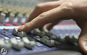 You may find that the action of a  mix compressor tends to 'fight' your fader moves when mixing.