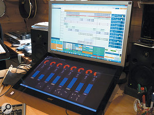 A multi-touch screen can be used quite effectively in conjunction with a  standard screen. In this setup, Usine Hollyhock is being used on a  touchscreen to control Tracktion 5 (visible on the upper display).