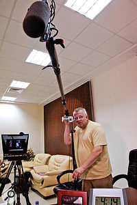 Simon Bishop positions his favoured shotgun mic on a boom arm.