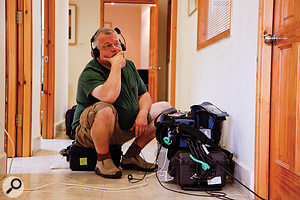 Simon Bishop monitors the progress of an interview from his glamorous perch in the corridor outside!