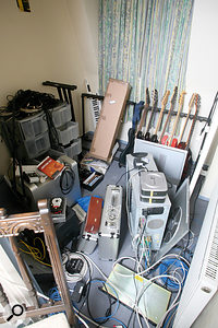 The small room adjacent to the studio, which serves as a machine room-cum-junk store.
