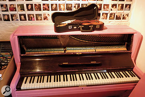 """The 'pink piano' can be heard on the new Peugeot commercial,"" says Phil Thornalley. ""It has brackets across the hammer felts to give it an authentic bar‑room sound. Records like a dream. We have a Yamaha grand, but it doesn't have as much character as this. We bought it cheap because the piano dealer knew no one else would take it!"""
