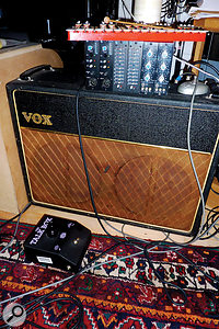"""Phil Thornalley: """"Ibought the Vox AC30 in 1978 from Macari's on Charing Cross Road. It's wired using one 12‑inch speaker in aseparate soundproofed cabinet, with aShure SM58 pointing straight at the cone. Impossible to get athin sound from that amp. One of our API Lunchboxes sits on top because there's no space elsewhere."""""""