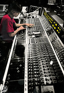 Phil Thornalley in his 1981 heyday as an engineer, mixing the Cure's Pornography album on the API desk at RAK Studios.