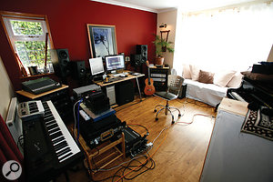 Jonathan Dodd's Realpiano studio: the piano (right) is housed in the same room as his recording setup.