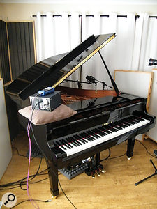 The Disklavier in all its glory, with Hugh's test-tone rig sitting on acushion.