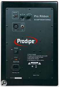 The rear panel includes balanced and unbalanced analogue audio connections,switchable-voltage power inlet, and volume and HF controls.