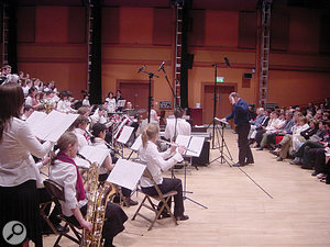 With amateur orchestras, balancing can be a big concern. Typically, brass can be too overbearing and drown out the woodwind section, so it may be worth directing a cardioid mic specifically towards the woodwinds for safety.