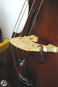 The 'modern' method of recording adouble bass in the studio is to 'bug' it, often with apickup fitted on the instrument's bridge. Any 'character' lost in the sound is then usually EQ'd back in. However, the 'vintage' way would have been to use careful mic and instrument placement, in conjunction with carefully placed acoustic treatment, to provide adegree of separation.