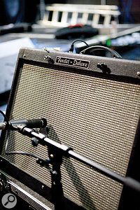 Making an amp quieter for the purposes of recording is an ongoing problem for recordists who want an authentic sound.