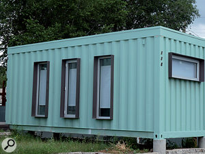 People have used shipping containers for all kinds of things, and one could, indeed, be used as a studio! However, unless you specifically wanted it to be easily transportable, the amount of work that would be needed to make such a container into a usable studio would probably be excessive.