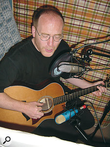 Recording a vocalist with two figure‑of‑eight mics can produce very good results. If the performer wants to play and sing at the same time, careful positioning to reject the unwanted sound from both mics (the vocals from the guitar mic and the guitar from the vocal mic) can achieve excellent separation.